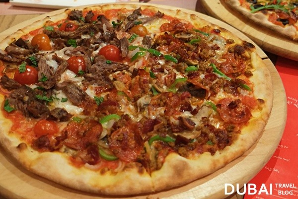 meat pizza itzza pizza dubai