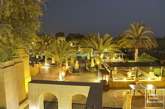 swimming pool at night bab alshams