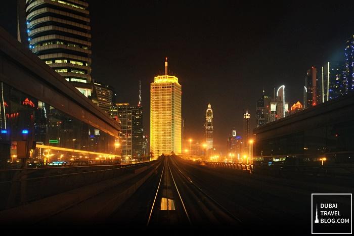 world trade center from dubai metro night shot