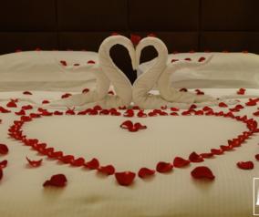 Romantic Bed Arrangement by Nour Arjaan Hotel Apartment