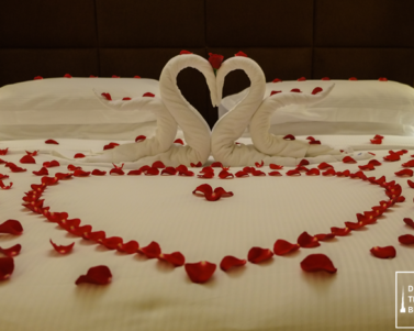 Romantic Bed Arrangement by Nour Arjaan Hotel Apartment