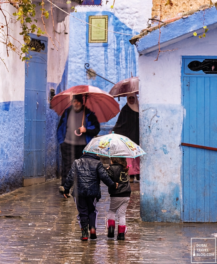 kids in morocco umbrella