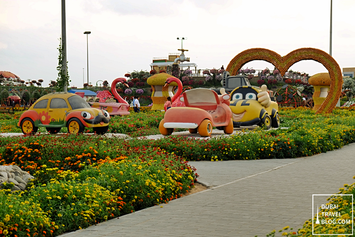 cars and flowers in dubai miracle garden