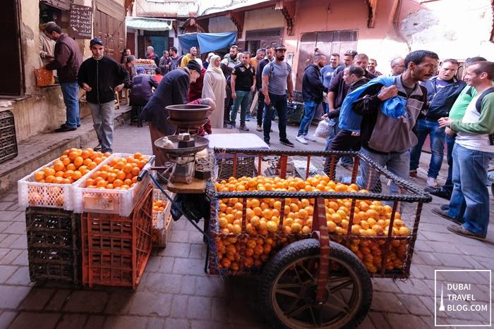 orange fruit vendor fez morocco
