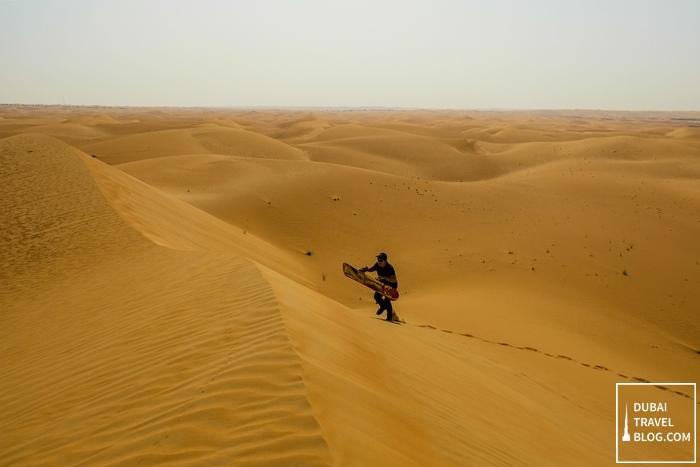 sandboarding-in-al-faqa-desert