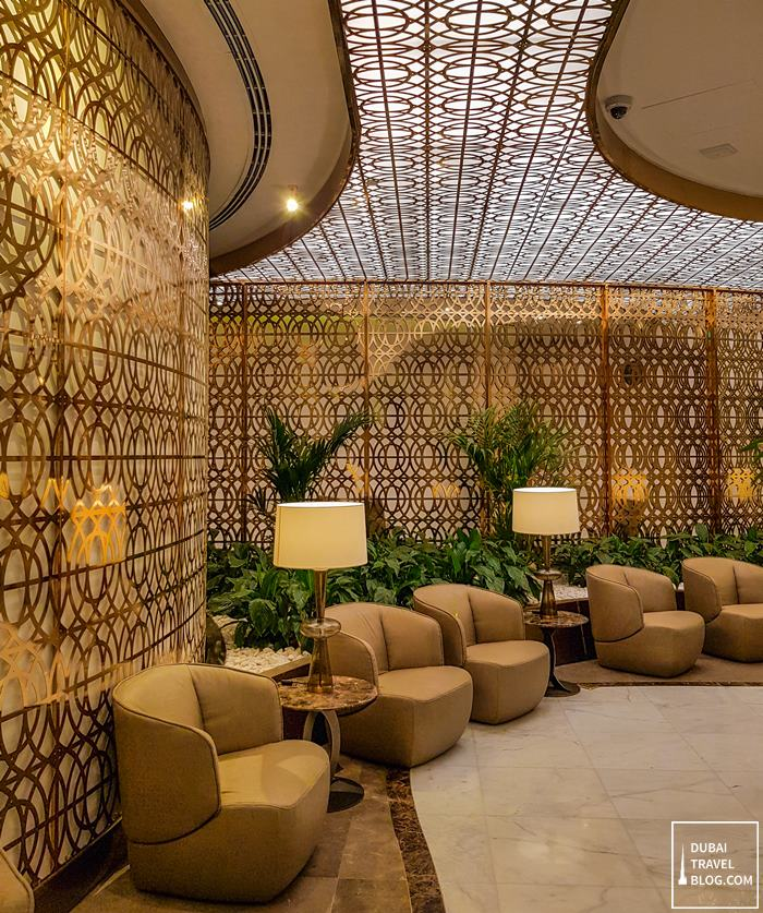 gold accents first business lounge oman air